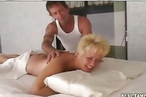 non-professional mother drilled on massage table